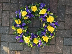 Purple, blue, yellow, wreath, funeral flowers, funeral tribute, gravesend