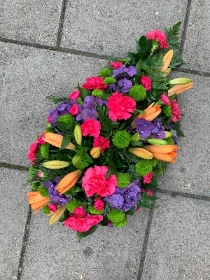 Vibrant, lily, spray, Funeral, sympathy, wreath, tribute, flowers, florist, gravesend, Northfleet, Kent, london